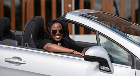 The Reverend Naomi Kaiga and her new convertible