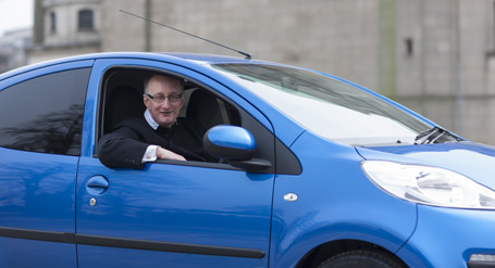 Father Richard Duncan takes delivery of not one, but two new cars